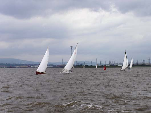 picture of boats in a tide race